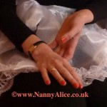 Nanny's slender caring hands - London AB/DL nursery, UK
